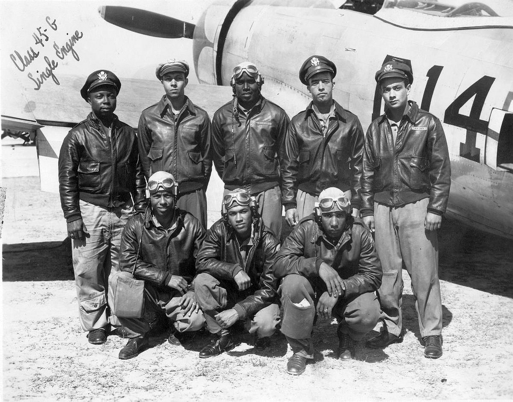 Tuskegee Airmen, in front of a P-47 fighter plane. WWII